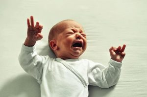photo of an infant boy crying