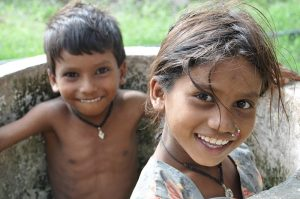 a photo of a young boy and girl siblings sitting together