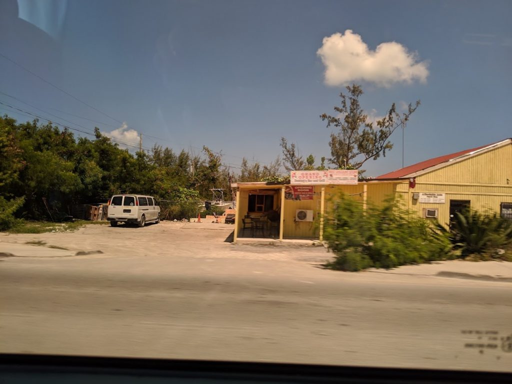 A photo of an impoverished home along a road