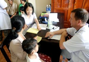 Vietnamese family at a military clinic