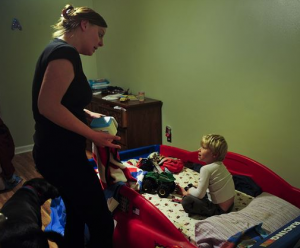 a mother putting her son to bed