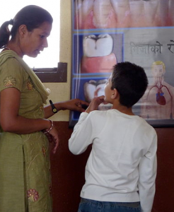 An adult female talking with a young boy