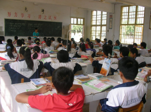 a photo of a middle school kids sitting at desks in a classroom