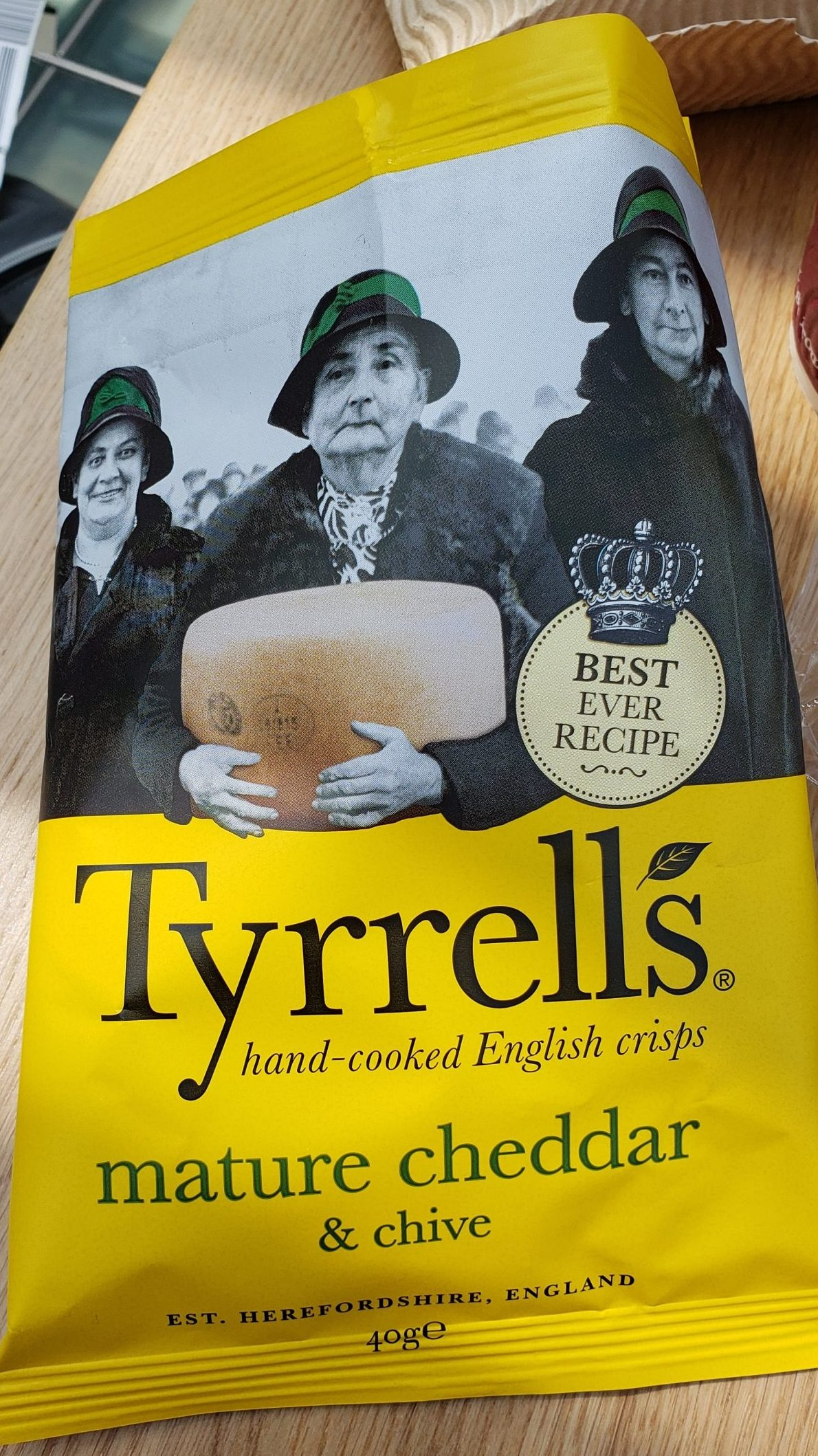 Potato chip bag highlighting a black and white photo of moderately grumpy old women holding a wheel of cheese